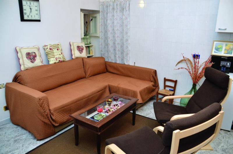 The seating area of the living room, showing the large (and very comfortable) sofa-bed