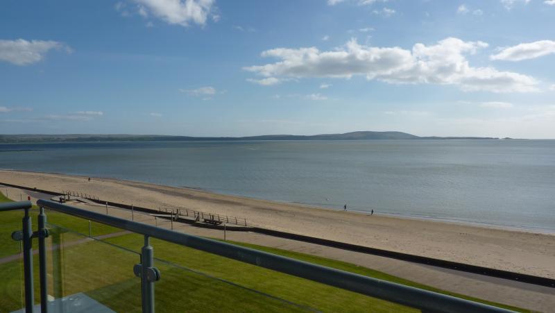 View from lounge balcony towards Gower at high tide