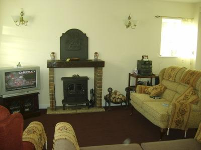 Furnished living room. Two double sofas, one  a sofabed, reclining armchair. DVD, CD  TV VIDEO