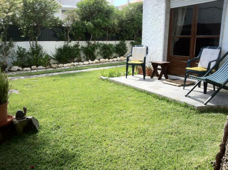 Nice garden of the property with sun loungers