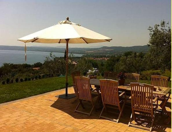Dining table on terrace with sun chairs, lounge, private