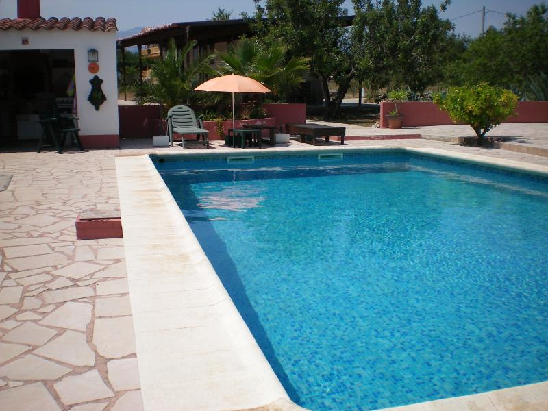 Large, relaxing pool & sunbathing area surrounded by well maintained gardens (inc. outside fridg