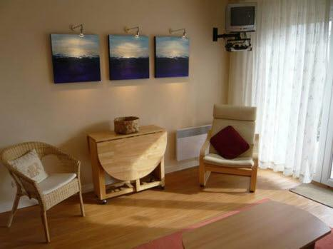 Bright living area with satellite TV and wifi