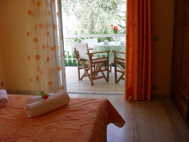 orange bedroom overlooking the terrace