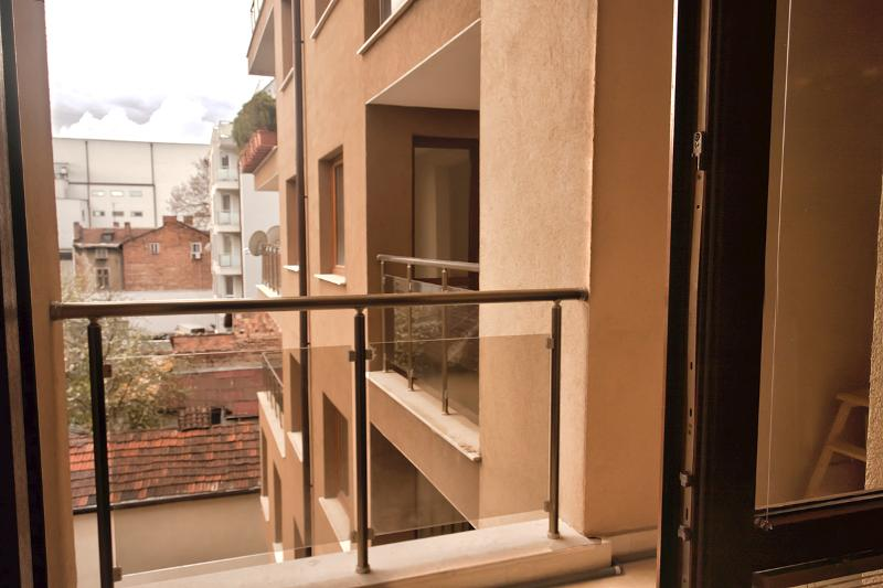 door to the balcony where you will find a small table with two chairs
