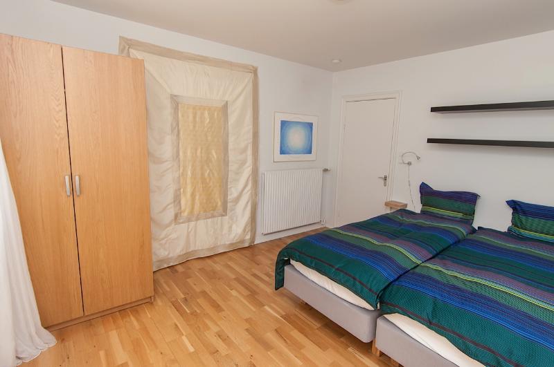 Big bedroom with art