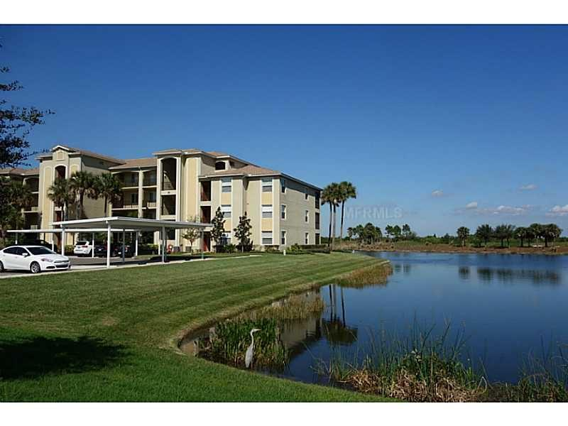 Beautiful main floor end unit with lake and golf course views