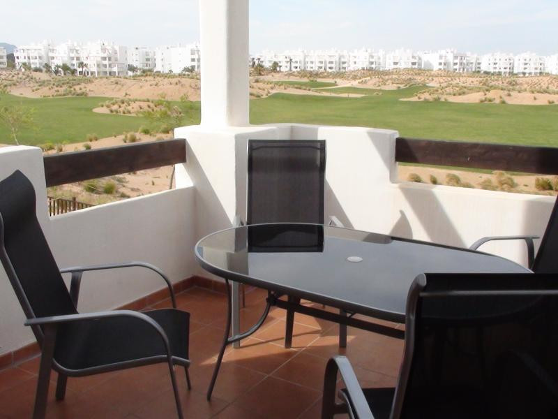 terrace with a view over the golf course and swimming pool