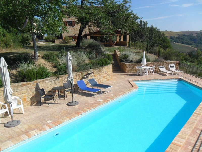 Pool with house and loggia in background