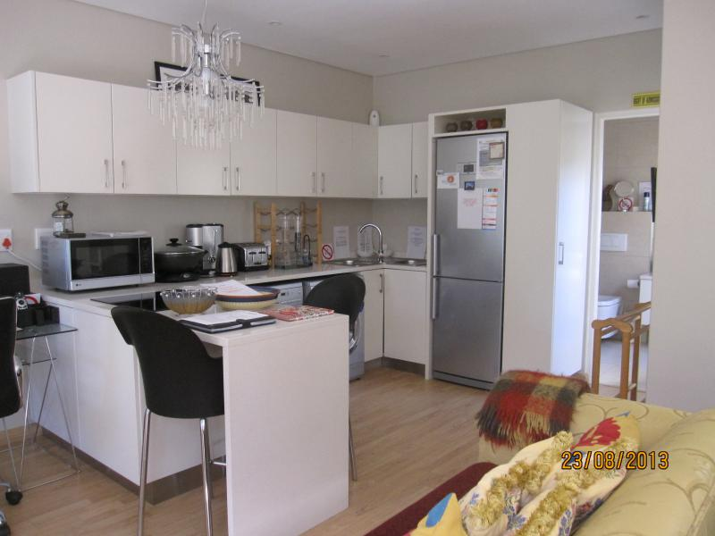 Kitchen - fully self contained - fridge, stove, oven, dishwasher, washer/drier, microwave, c/machine