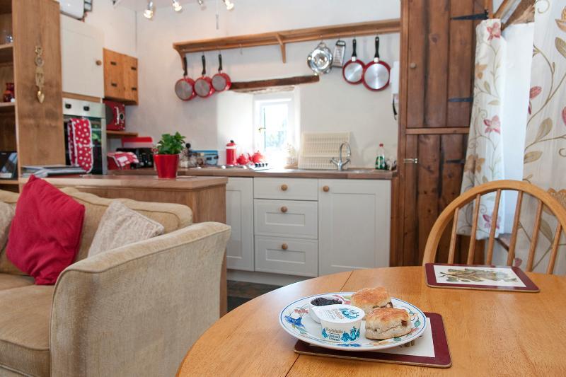 Kitchen with oven, hob & fridge.