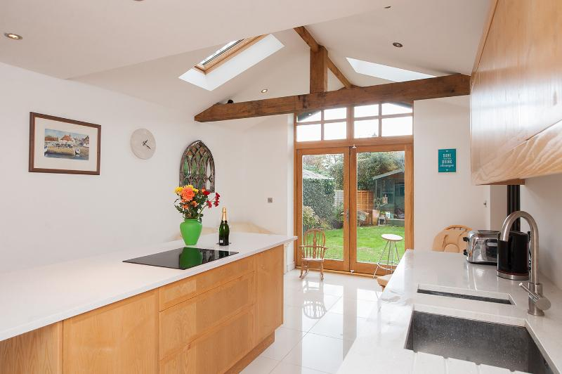 New 15ft Oak double-glazed french doors to onto rear garden. Vaulted ceiling, supporting oak beams.