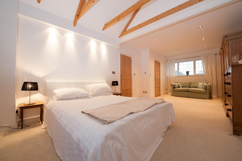 Master bedroom, new thick pile carpet, antique pine furniture throughout. Wooden ceiling beams.