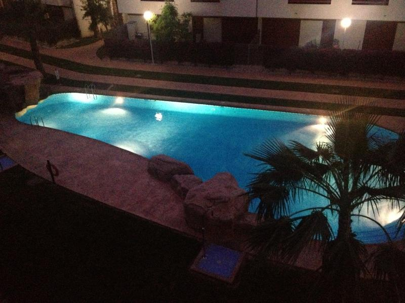 One of the 2 pools as seen at night from the lower balcony
