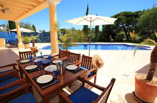 Al fresco dining by your own private heated pool outside your luxury 4 bedroom villa