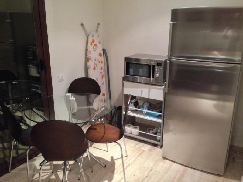 Kitchen - Breakfast table/chairs, fridgefreezer, microwave, vacuum cleaner, ironing board