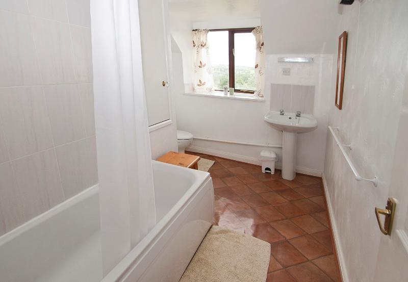 THIS IS THE FULL SIZE BATHROOM.[BATH WITH SHOWER,TOILET WASH HAND BASIN]
