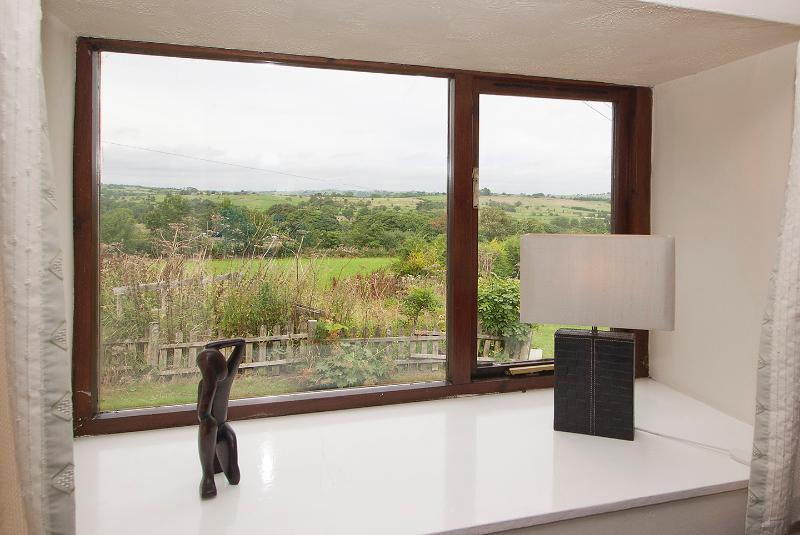 THIS IS A PHOTO TAKEN FROM THE LOUNGE OVERLOOKING THE MEADOW AND BEYOND TO THE PEAK DISTRICT