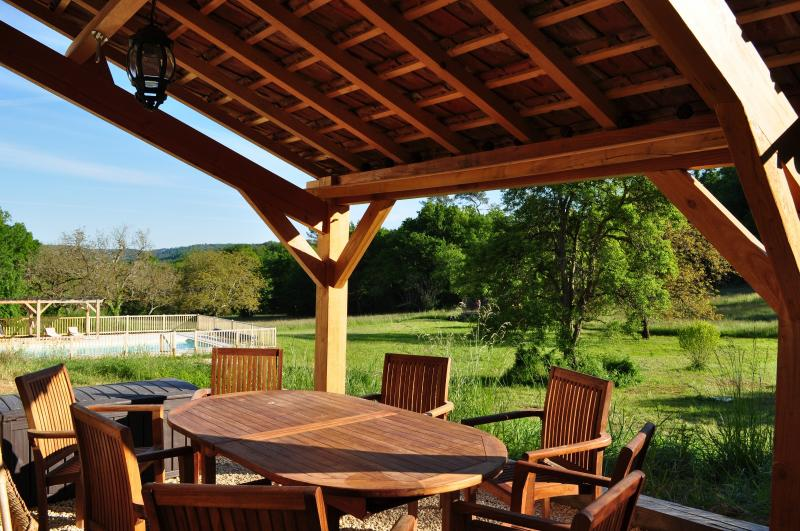 Outdoor dining at Hope Cottage overlooking the meadow and pool