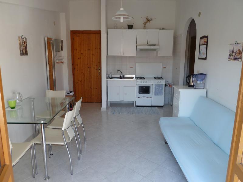 Living room, open plan kitchen