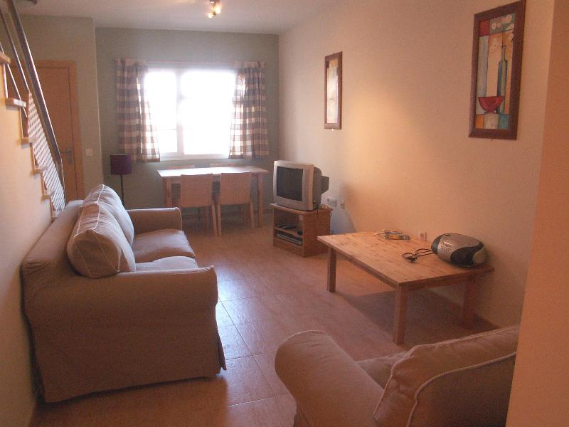 Living room with sofa-bed, UK TV (channels 1-5), DVD and CD players