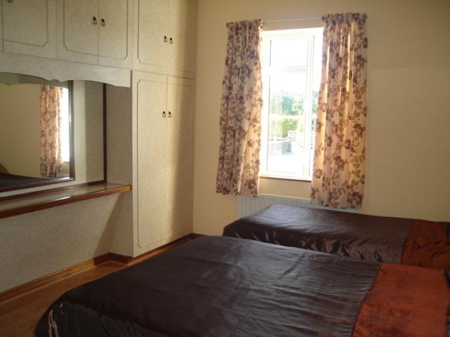 Bedroom 2 has a double and single bed, with built in wardrobe and dressing table.