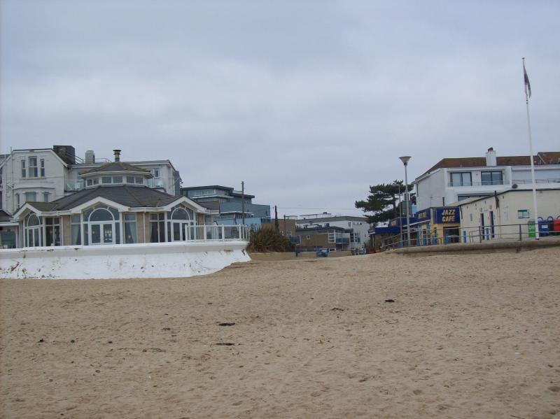 nearby beach: hotel with balcony to left and jazz cafe to the right  (allows dogs)