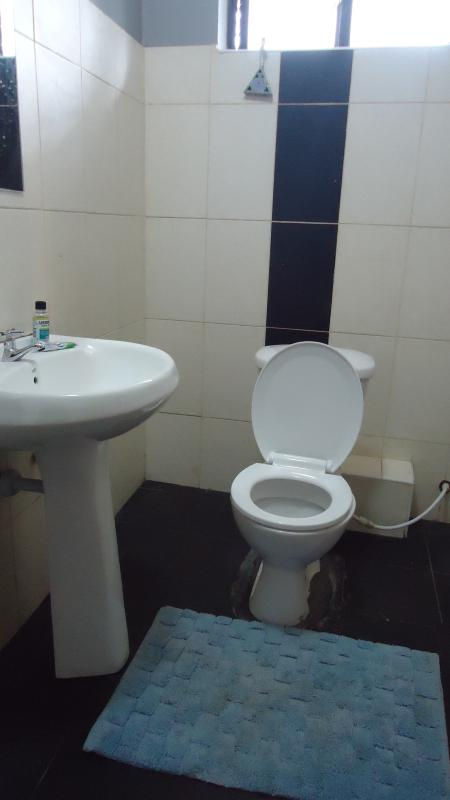 Clean and spacious toilet/ with hot showers