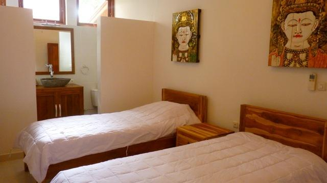 The downstairs bedroom has two large single beds and an en suite bathroom.