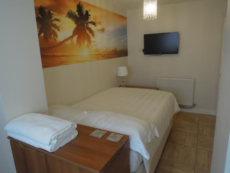 Chambre à coucher avec salle de bains Apt 2