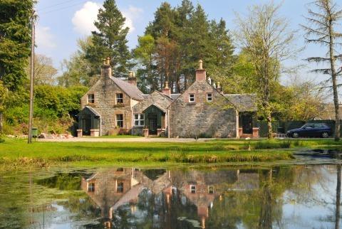Highland Coach House (2 storey property on left)