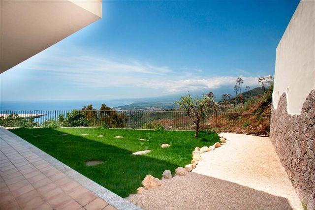 the garden and outside area with Etna and Giardini Naxos view