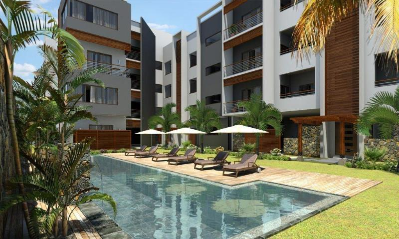 The backside of the residence, apartment on the ground floor opposite the swimming pool