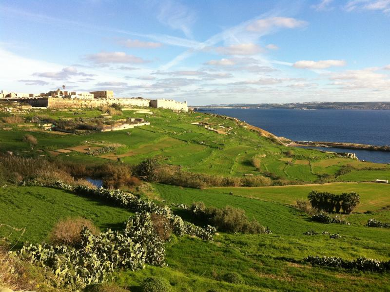 Fort Chambray in its winter splendour overlooking the lush green fields and the blue Mediterranean