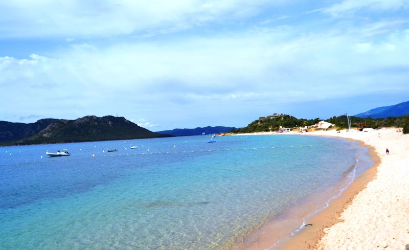 The sandy Cala Rossa beach
