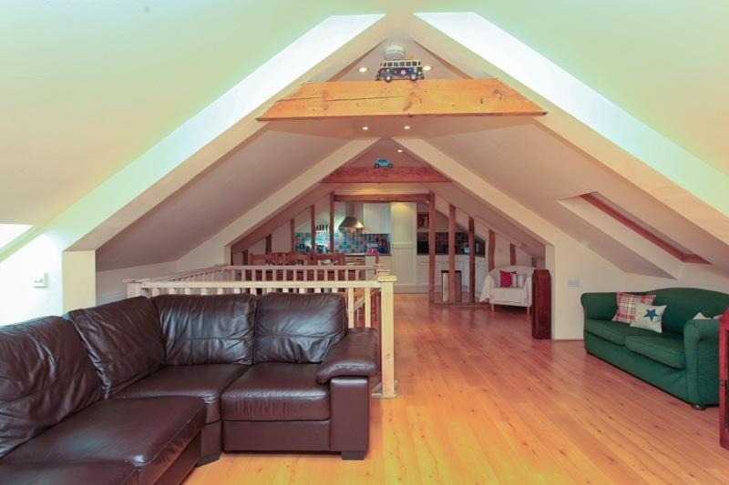 The top floor is open plan, located in the beams of the old barn
