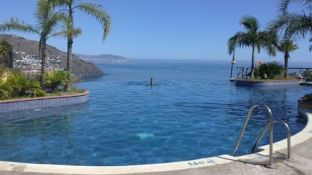 infinity pool in front of the house. select and relaxing atmosphere.
