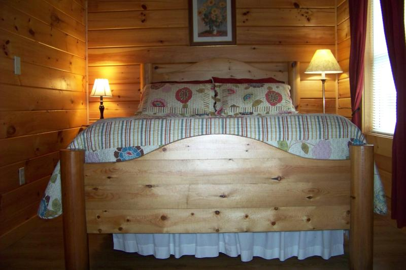 Queen size log bed in Jack's little log cabin