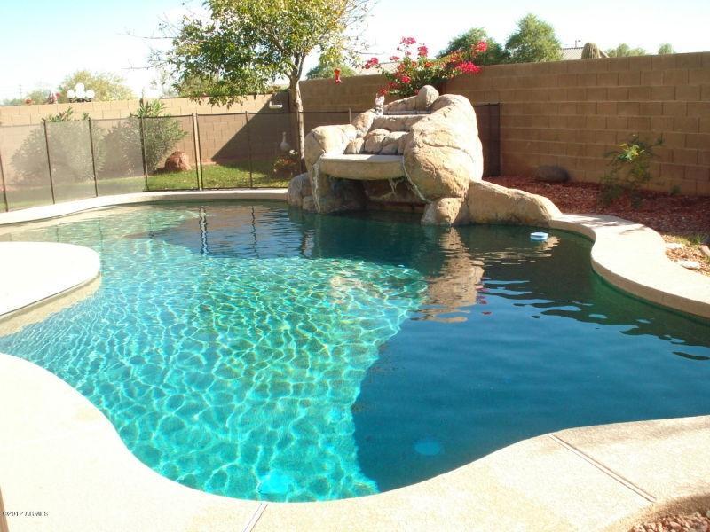 Pebble Tech pool with waterfall.
