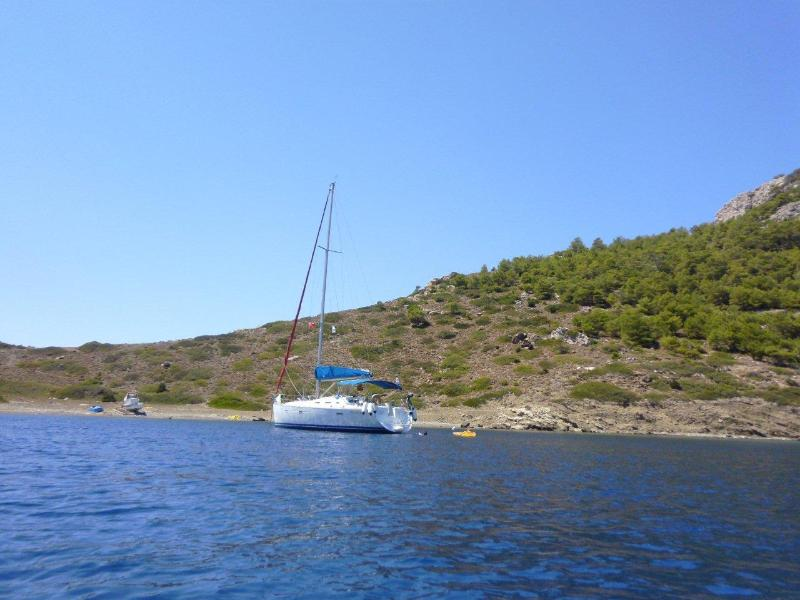 Fusion at anchor in one of Symi's many bays