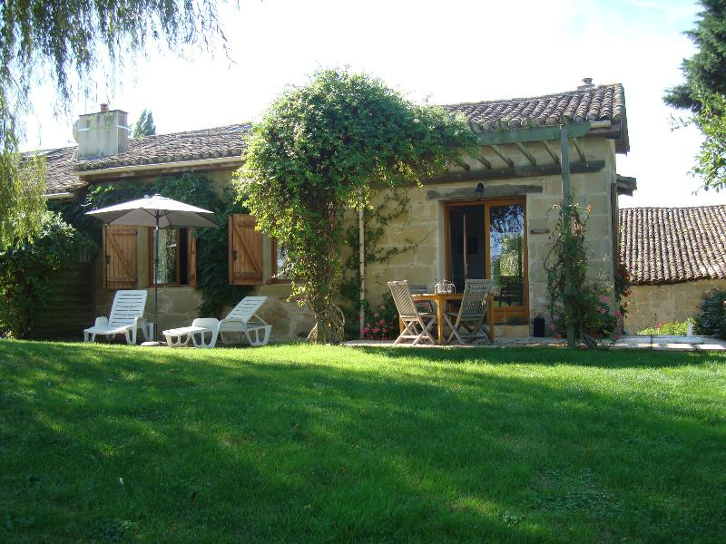 Duck Cottage sun terrace overlooking the garden towards the pool. Ideal for alfresco dining!