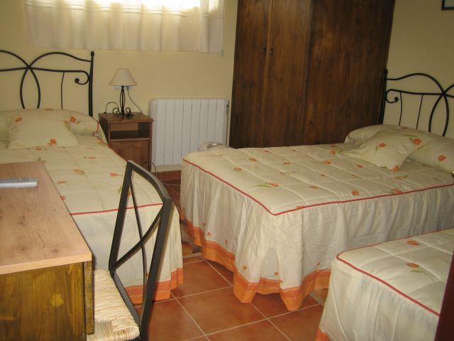 Dormitorio triple G