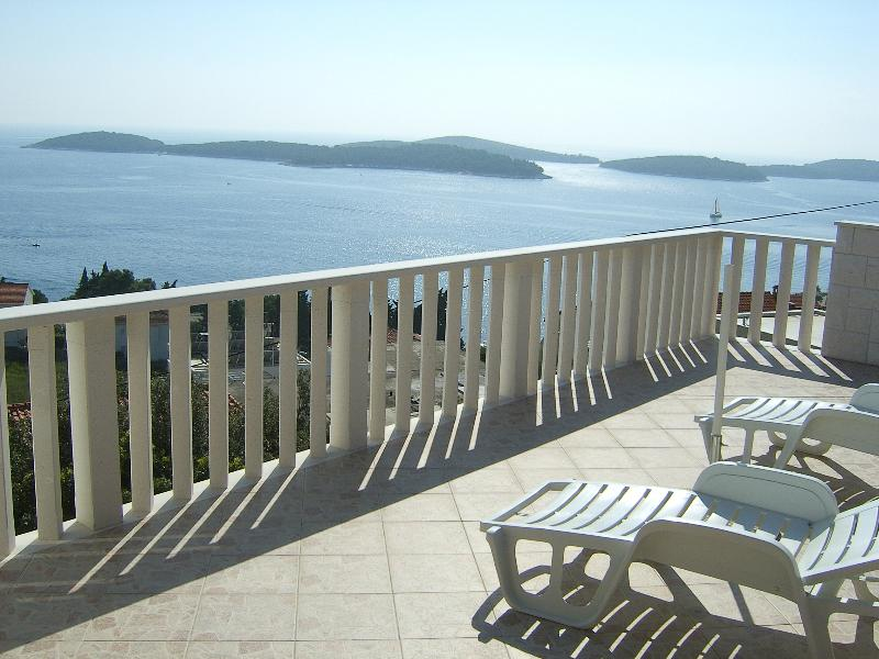 Relax on the deck chairs on the balcony with an incredible view