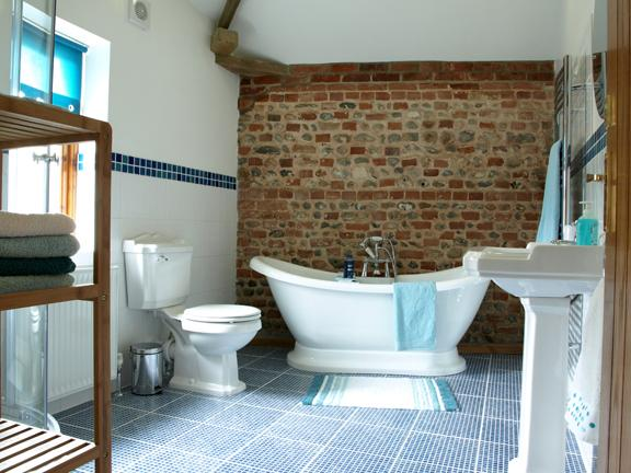 Main bathroom - Free standing boat bath and shower cubical - there is also an on suite in bedroom.