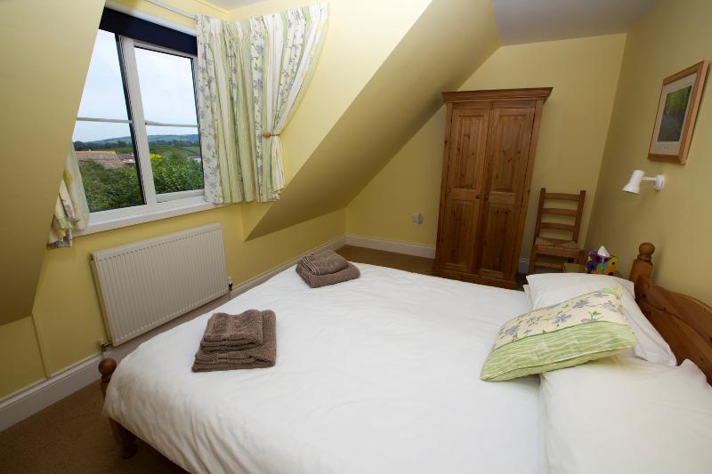 Double bedroom with views towards distant hills