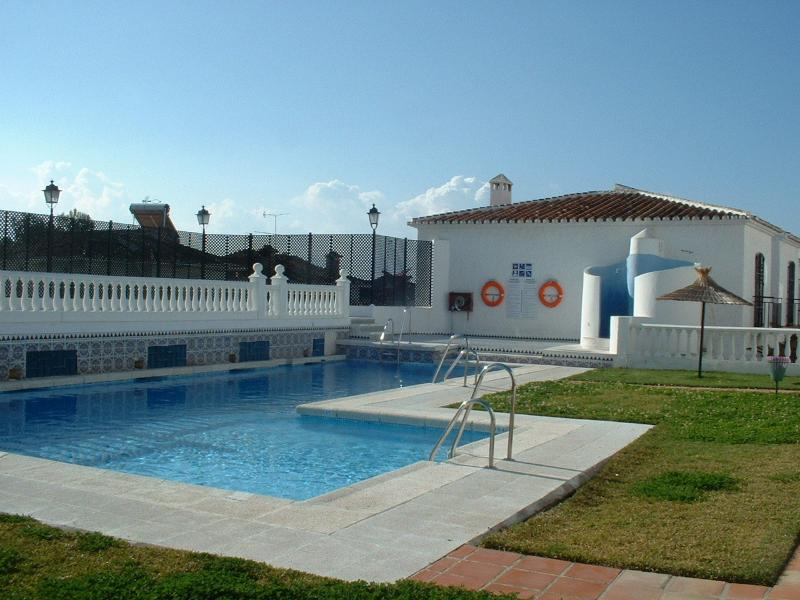 Larger of the 2 community pools with sunbathing areas.
