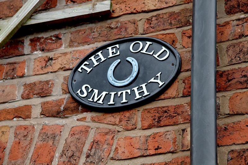 Well signed 'The Old Smithy'
