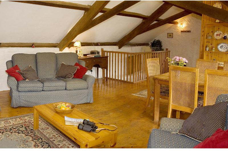 Bracken Cottage - Another view of the Living room, exposed beams and a log fire