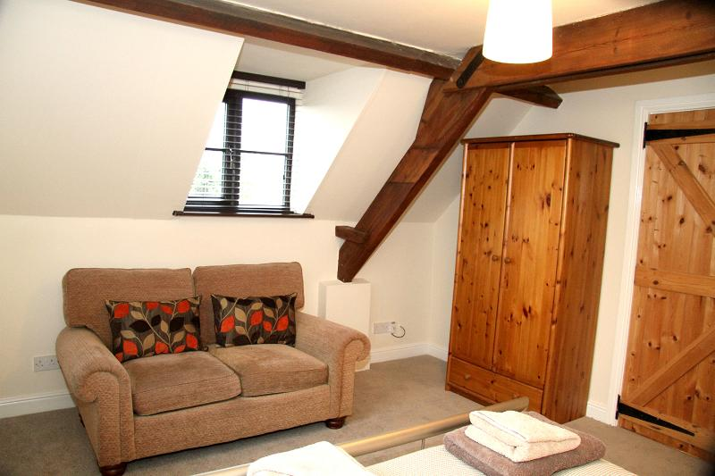 1st double bedroom with settee and tv