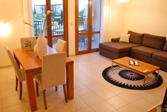 Spacious open plan living/dining room with french doors to balcony
